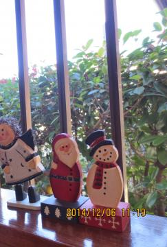 santa and snowman by the window at entrance